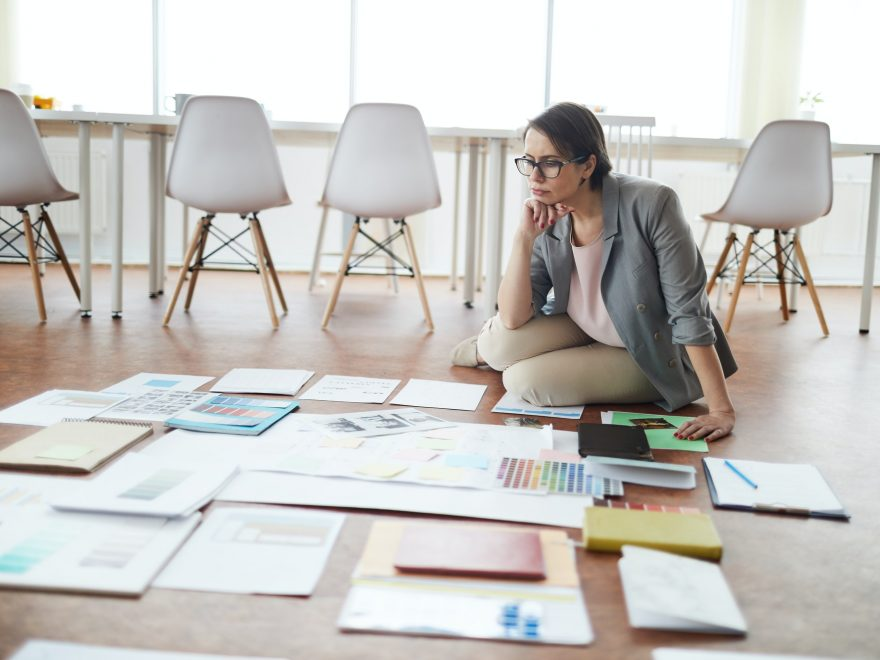 Businesswoman Planning Project on Floor