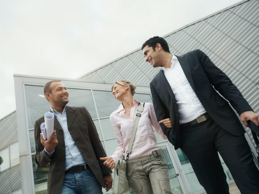 Team Of Architects Walking Outside Office